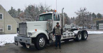 John Brown next to new 2021 Western Star Truck